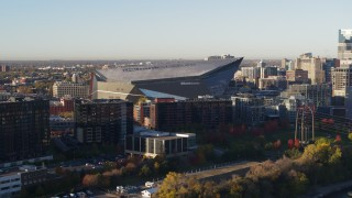 DX0001_002322 - 5.7K stock footage aerial video of flying away from US Bank Stadium at sunrise, Downtown Minneapolis, Minnesota