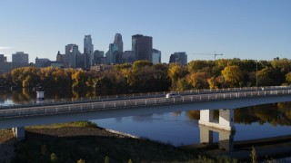 DX0001_002335 - 5.7K stock footage aerial video fly over bridge and river for view of city skyline, Downtown Minneapolis, Minnesota