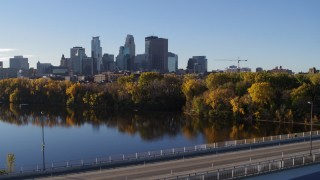 DX0001_002336 - 5.7K stock footage aerial video reverse view of city's skyline, revealing bridge and river, Downtown Minneapolis, Minnesota