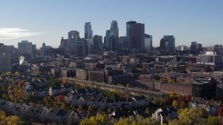 DX0001_002344 - 5.7K stock footage aerial video stationary view of the city skyline before flying away, Downtown Minneapolis, Minnesota