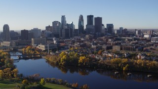 DX0001_002347 - 5.7K stock footage aerial video of flying over the river to approach skyline of Downtown Minneapolis, Minnesota