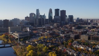 DX0001_002348 - 5.7K stock footage aerial video of flying away from the skyline of Downtown Minneapolis, Minnesota, descend toward river