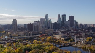 DX0001_002354 - 5.7K stock footage aerial video ascend to reveal the river with view of the skyline, Downtown Minneapolis, Minnesota