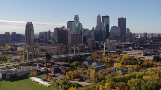 DX0001_002367 - 5.7K stock footage aerial video descend with view of the city's skyline and Mississippi River, Downtown Minneapolis, Minnesota