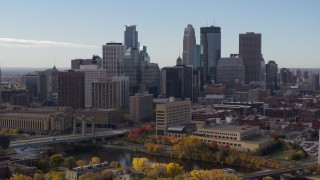 DX0001_002369 - 5.7K stock footage aerial video flyby the Mississippi River, with view of skyline of Downtown Minneapolis, Minnesota