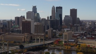 DX0001_002381 - 5.7K stock footage aerial video fly near bridge and towering skyscrapers of the city skyline, Downtown Minneapolis, Minnesota