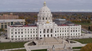 DX0001_002390 - 5.7K stock footage aerial video descend and reverse view of the Minnesota State Capitol in Saint Paul, Minnesota