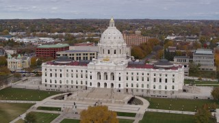 DX0001_002396 - 5.7K stock footage aerial video of the Minnesota State Capitol in Saint Paul, Minnesota as people walk through park