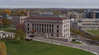 DX0001_002412 - 5.7K stock footage aerial video fly away from the front of the Minnesota Judicial Center courthouse building in Saint Paul, Minnesota