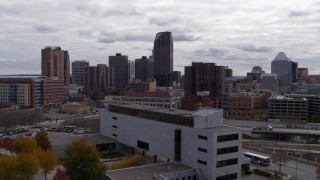 DX0001_002417 - 5.7K stock footage aerial video of passing by the city's downtown skyline in Downtown Saint Paul, Minnesota and ascend