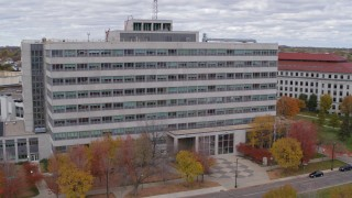 DX0001_002427 - 5.7K stock footage aerial video of flying by a government office building during descent in Saint Paul, Minnesota