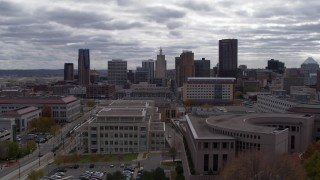 DX0001_002429 - 5.7K stock footage aerial video of the city's skyline seen from a wide street, and ascend, Downtown Saint Paul, Minnesota