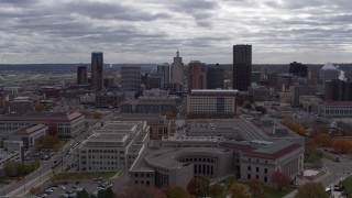 DX0001_002433 - 5.7K stock footage aerial video of flying by the city skyline before descending toward street, Downtown Saint Paul, Minnesota