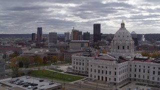 DX0001_002437 - 5.7K stock footage aerial video of the city skyline seen while flying by the state capitol building, Downtown Saint Paul, Minnesota