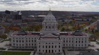 DX0001_002444 - 5.7K stock footage aerial video orbit state capitol building, with city skyline and cathedral in background, Saint Paul, Minnesota
