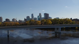 DX0001_002451 - 5.7K stock footage aerial video approach and fly over bridge spanning river with view of city skyline, Downtown Minneapolis, Minnesota