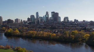 DX0001_002454 - 5.7K stock footage aerial video approach and flyby the city skyline, seen from Mississippi River, Downtown Minneapolis, Minnesota