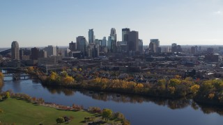 DX0001_002459 - 5.7K stock footage aerial video wide view of the city skyline on the other side of the river, Downtown Minneapolis, Minnesota
