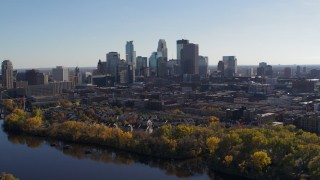 DX0001_002460 - 5.7K stock footage aerial video wide view of the city's skyline on the other side of the river, Downtown Minneapolis, Minnesota