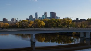 DX0001_002461 - 5.7K stock footage aerial video approach and fly over bridge to focus on skyline of Downtown Minneapolis, Minnesota