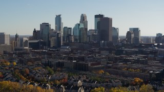 DX0001_002467 - 5.7K stock footage aerial video focus on city skyline while flying over river, Downtown Minneapolis, Minnesota
