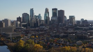 DX0001_002468 - 5.7K stock footage aerial video focus on city skyline while approaching from river, Downtown Minneapolis, Minnesota