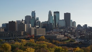 DX0001_002471 - 5.7K stock footage aerial video focus on skyscrapers while flying by the city skyline, Downtown Minneapolis, Minnesota