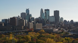 DX0001_002474 - 5.7K stock footage aerial video focus on skyscrapers while passing by the city skyline, Downtown Minneapolis, Minnesota