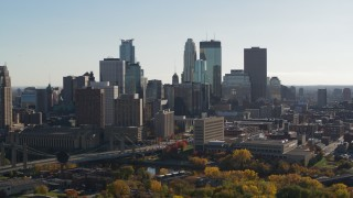 DX0001_002479 - 5.7K stock footage aerial video focus on tall skyscrapers during ascent to stationary view of the city skyline, Downtown Minneapolis, Minnesota