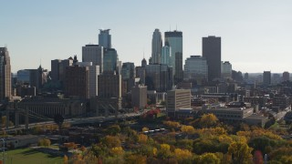 DX0001_002480 - 5.7K stock footage aerial video focus on the city skyline during descent, Downtown Minneapolis, Minnesota
