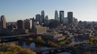 DX0001_002487 - 5.7K stock footage aerial video flying by the river with view of the city skyline, Downtown Minneapolis, Minnesota