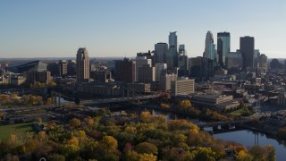 DX0001_002491 - 5.7K stock footage aerial video of flying by bridge spanning the river and the city skyline, Downtown Minneapolis, Minnesota