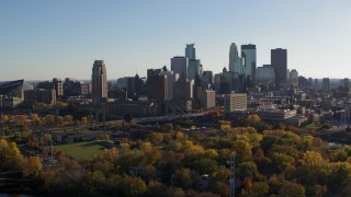 DX0001_002495 - 5.7K stock footage aerial video fly away from the city skyline across the Mississippi River, Downtown Minneapolis, Minnesota