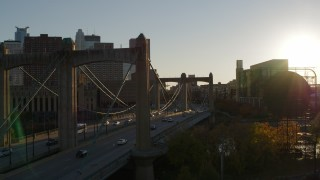 DX0001_002502 - 5.7K stock footage aerial video ascend from Hennepin Avenue Bridge at sunset in Downtown Minneapolis, Minnesota