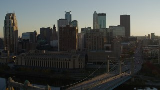 DX0001_002503 - 5.7K stock footage aerial video fly away from Hennepin Avenue Bridge and apartment buildings at sunset in Downtown Minneapolis, Minnesota