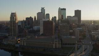 DX0001_002513 - 5.7K stock footage aerial video flyby skyscrapers and descend by Hennepin Avenue Bridge at sunset, Downtown Minneapolis, Minnesota