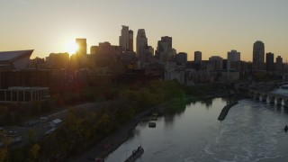 DX0001_002526 - 5.7K stock footage aerial video of the skyline at sunset from the Mississippi River, Downtown Minneapolis, Minnesota