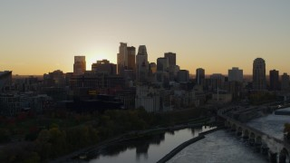 DX0001_002531 - 5.7K stock footage aerial video of city skyline across the Mississippi River at sunset, Downtown Minneapolis, Minnesota