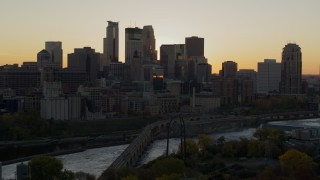 DX0001_002536 - 5.7K stock footage aerial video of city skyline across the Mississippi River at sunset, and reveal the power plant, Downtown Minneapolis, Minnesota