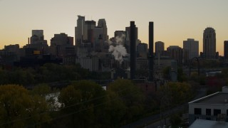 DX0001_002537 - 5.7K stock footage aerial video flyby the power plant with city skyline in background at sunset, Downtown Minneapolis, Minnesota