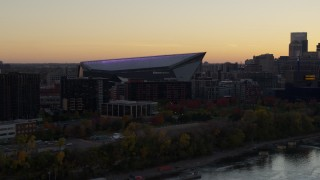 DX0001_002543 - 5.7K stock footage aerial video approach US Bank Stadium from the river at sunset, Downtown Minneapolis, Minnesota