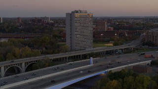 DX0001_002548 - 5.7K stock footage aerial video of a condo complex seen from a bridge at sunset, Minneapolis, Minnesota