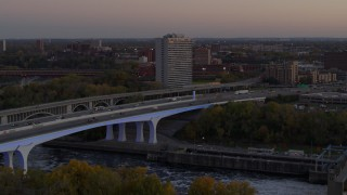 DX0001_002550 - 5.7K stock footage aerial video fly away from a condo complex beside a bridge at sunset, Minneapolis, Minnesota