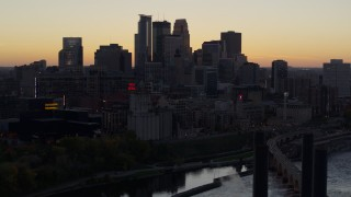 DX0001_002557 - 5.7K stock footage aerial video of the city's skyline across the river at sunset, reveal a bridge, Downtown Minneapolis, Minnesota