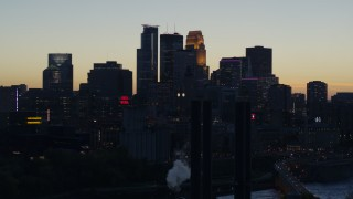 DX0001_002566 - 5.7K stock footage aerial video of the city skyline across the river at twilight, seen from power plant, Downtown Minneapolis, Minnesota