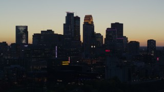 DX0001_002567 - 5.7K stock footage aerial video ascend from power plant for view of the city skyline across the river at twilight, Downtown Minneapolis, Minnesota