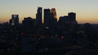 DX0001_002570 - 5.7K stock footage aerial video of focusing on the skyscrapers in the city skyline at twilight, Downtown Minneapolis, Minnesota