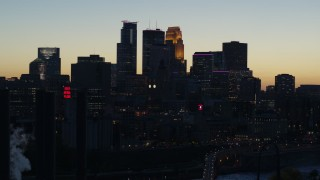 DX0001_002571 - 5.7K stock footage aerial video flyby the skyscrapers in the city skyline at twilight, reveal smoke stacks, Downtown Minneapolis, Minnesota