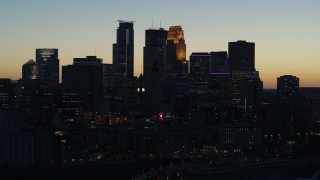 DX0001_002574 - 5.7K stock footage aerial video of the skyscrapers in the city skyline at twilight during descent, Downtown Minneapolis, Minnesota