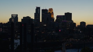 DX0001_002575 - 5.7K stock footage aerial video flyby the skyscrapers in the city skyline at twilight, Downtown Minneapolis, Minnesota